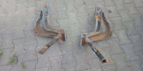 9418910631 Actros uchwyt wspornik błotnika L/P